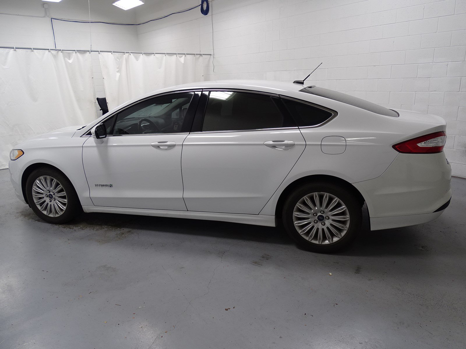 Pre owned 2014 ford fusion se hybrid 4dr car 1dw8219 ken garff automotive group